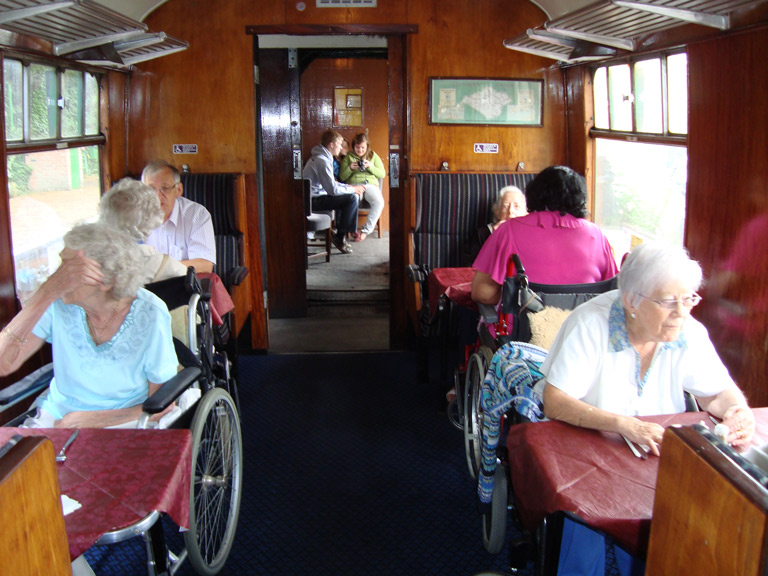 Pat and Joan on the train in their wheelchairs